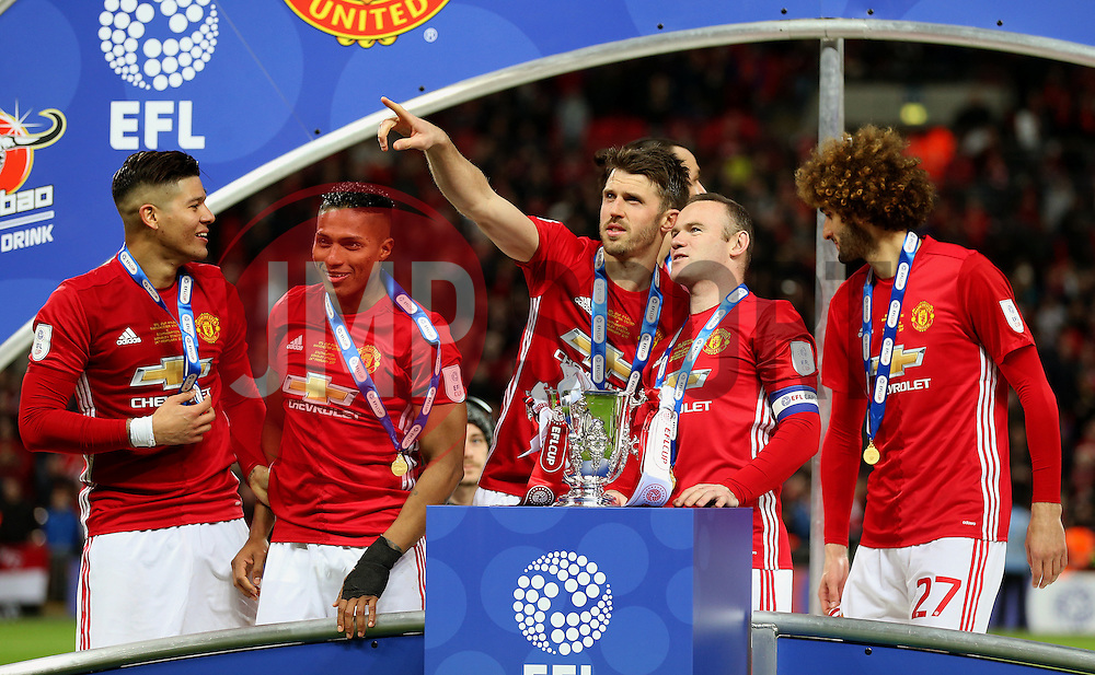 Michael Carrick of Wayne Rooney of Manchester United with the EFL Trophy - Mandatory by-line: Matt McNulty/JMP - 26/02/2017 - FOOTBALL - Wembley Stadium - London, England - Manchester United v Southampton - EFL Cup Final