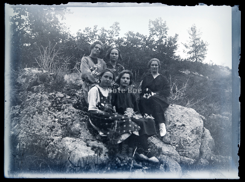 women only group sitting on a large rock France circa 1920s