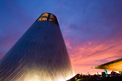Hot shop cone of Museum of Glass, and Chihuly Bridge of Glass at sunset, Tacoma, Washington, USA