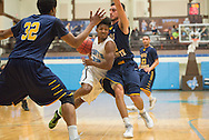 2/2/16 – Medford/Somerville, MA – Tufts guard Tarik Smith, A17, charges through two UMass Dartmouth players in the men's basketball game against UMass Dartmouth on Tuesday, Feb. 2, 2016. (Evan Sayles / The Tufts Daily)