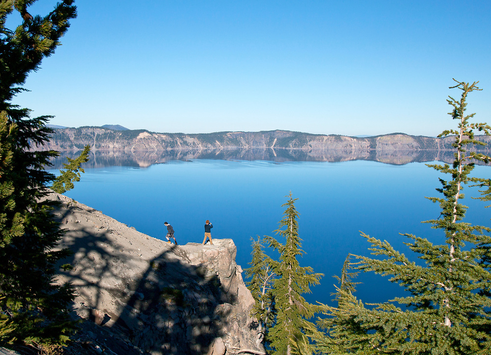 Crater Lake, Southern Oregon. Wikipedia: Crater Lake is a caldera lake in south-central Oregon in the western United States. It is the main feature of Crater Lake National Park and is famous for its deep blue color and water clarity. The lake partly fills a nearly 2,148-foot-deep caldera that was formed around 7,700  years ago by the collapse of the volcano Mount Mazama. There are no rivers flowing into or out of the lake; the evaporation is compensated for by rain and snowfall at a rate such that the total amount of water is replaced every 250 years. With a depth of 1,949 feet the lake is the deepest in the United States