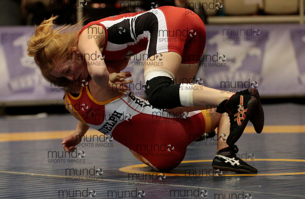 London, Ontario ---2013-03-02---  Jade Papke     of Guelph     takes on Diana Ford of  Brock in the women's 51kg gold medal match at the 2013 CIS Wrestling Championships in London, Ontario, March 02, 2013. .GEOFF ROBINS/Mundo Sport Images