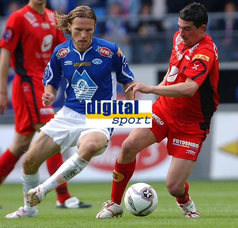 Fotball tippeligaen 23.06.05 - Molde - Brann<br /> Daniel Berg Hestad og Paul Scharner<br /> Foto: Carl-Erik Eriksson, Digitalsport