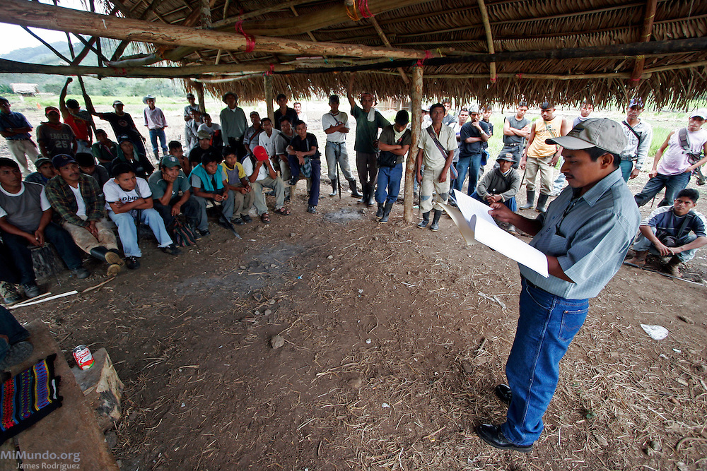 Locals gather to discuss a possible eviction. In September 2006, hundreds of Q'eqchi' Maya families from Chichipate, El Estor, Guatemala, built the community of Barrio La Revolución on an unused land plot officially registered to the Guatemalan Nickel Company (CGN). Residents of Chichipate assert the land plot was illegally carved out from the community and given to INCO's Exmibal Nickel mine in the mid 1960s. As Chichipate's population has grown, local Q'eqchi' Maya families claim legal and ancestral rights to the unused land plot.