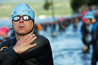 JEROME A. POLLOS/Press..Jose deSouza, from Great Falls, Mont., stretches before the start of the 2.4-mile swim Sunday during the Ford Ironman Coeur d'Alene.