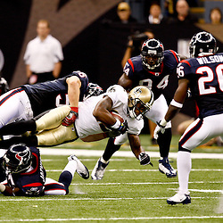 August 21, 2010; New Orleans, LA, USA;New Orleans Saints wide receiver Marques Colston (12) is tackled by Houston Texans linebacker Brian Cushing (56) during the first quarter of a preseason game at the Louisiana Superdome. Mandatory Credit: Derick E. Hingle