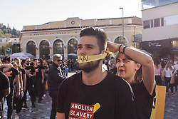 October 14, 2017 - Athens, Attiki, Greece - Greek human right activists take part in the 2017 Walk for Freedom event raising awareness about Human Trafficking. (Credit Image: © George Panagakis/Pacific Press via ZUMA Wire)