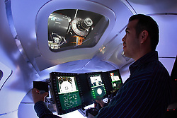 A man operating a NASA training simulator.