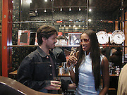 Guido and Naomi Campbell. Shanghai Tang opening. Sloane St. 11 April 2001. © Copyright Photograph by Dafydd Jones 66 Stockwell Park Rd. London SW9 0DA Tel 020 7733 0108 www.dafjones.com