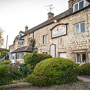 Outside of the famous, historic pub the Butcher's Arms in Sheepscombe in the Cotswolds, United Kingdom.