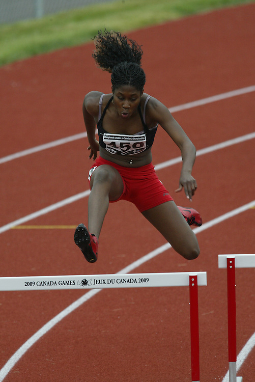 (Charlottetown, Prince Edward Island -- 20090718) Farah Jacques of Perfmax-Racing competes in the 400m hurdles semi-finals,  at the 2009 Canadian Junior Track & Field Championships at UPEI Alumni Canada Games Place on the campus of the University of Prince Edward Island, July 17-19, 2009.  Copyright Sean Burges / Mundo Sport Images , 2009...Mundo Sport Images has been contracted by Athletics Canada to provide images to the media.