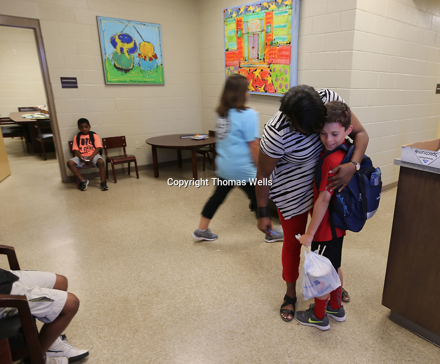 Donita Patterson gives one last hug to John Orman as he leaves Corinth Elementary School for his last day of school on Thursday.