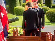 23 JULY 2015 - BANGKOK, THAILAND:  NGUYEN TAN DUNG (left back to camera), Prime Minister of Vietnam,  and PRAYUTH CHAN-O-CHA, Prime Minister of Thailand, (right) walk back to Government House after the welcoming ceremony for the Vietnamese Prime Minister. The Vietnamese Prime Minister and his wife came to Bangkok for the 3rd Thailand - Vietnam Joint Cabinet Retreat. The Thai and Vietnamese Prime Minister discussed issues of mutual interest.     PHOTO BY JACK KURTZ