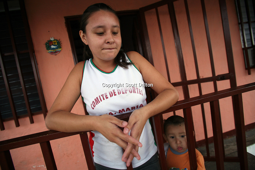 Sonia Garcia Acevedo, a Colombian refugee, stands with her young son in front of her house in Ciudad Sucre, near the Venezuelan and Colombian border, on Wednesday, February 13, 2008. The border region of Venezuela is becoming increasingly more dangerous as reports of activity of Colombia?s illegal armed groups in Venezuela have been on the rise. (Photo/Scott Dalton).