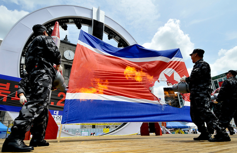 Former members of the South Korean military, trained to infiltrate North Korea, burn a Korth Korean flag during a protest against North Korea in Seoul, South Korea