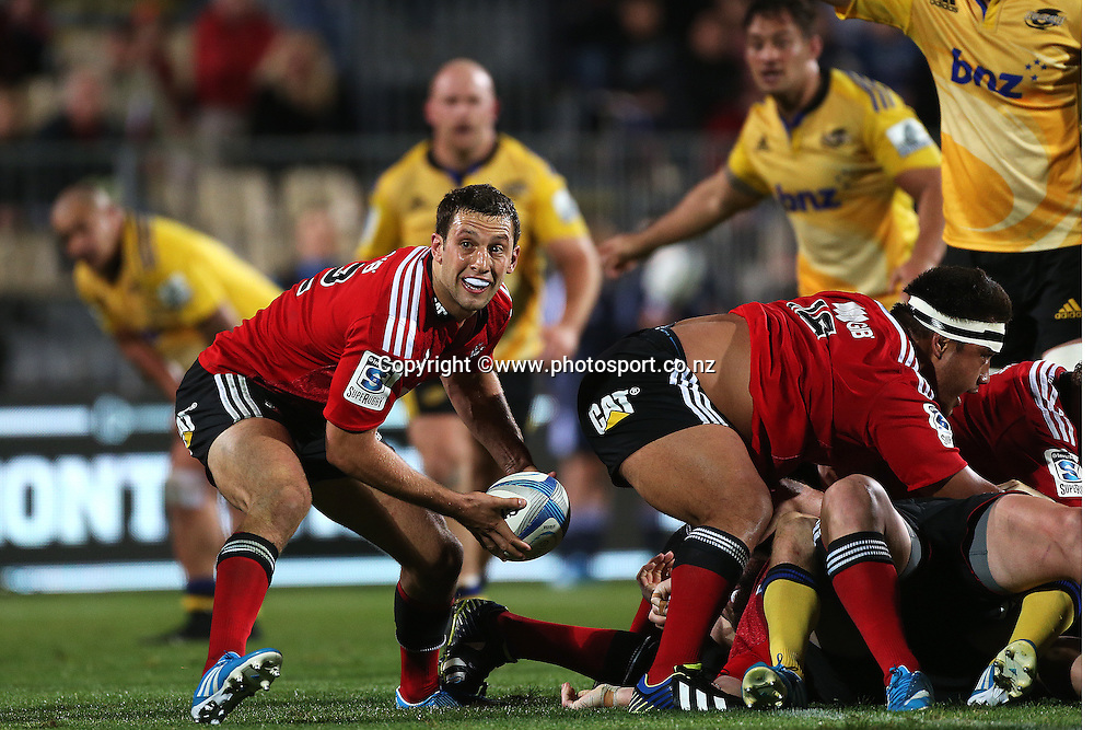 Tom Taylor of the Crusaders clears the ball from a ruck during the opening round of the Investec Super Rugby between Crusaders v Hurricanes at AMI Stadium, Christchurch. 28 March 2014 Photo: Joseph Johnson/www.photosport.co.nz