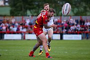 Bradford Bulls scrum half Joe Keyes (7) is caught after his kick through by Dewsbury Rams Lucas Walshaw (4) and ends up with an injury during the Kingstone Press Championship match between Dewsbury Rams and Bradford Bulls at the Tetley's Stadium, Dewsbury, United Kingdom on 4 June 2017. Photo by Simon Davies.