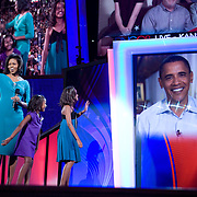 Michelle Obama and daughters speak to Sen. Barack Obama via satellite at the Democratic National Committee (DNC) Convention on the first day at the Pepsi Center in Denver, Colorado (CO) Monday, Aug. 25, 2008.  ..Photo by Khue Bui