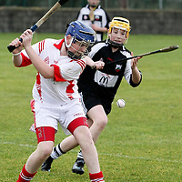 Eire Ogs Nathan Murray clears under pressure from Clarecastles Derek Casey during the Mother Hubbards U13 Div 1 Final at Clarecastle.Pic Arthur Ellis/Press22.