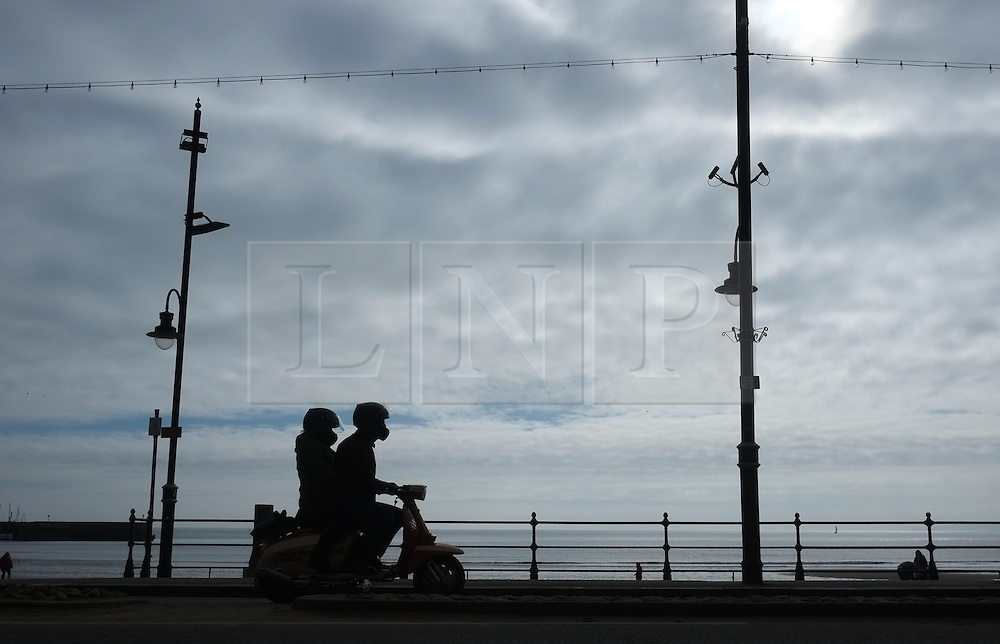&copy; Licensed to London News Pictures. <br /> 05/04/2015. <br /> <br /> Scarborough, United Kingdom<br /> <br /> A scooter is ridden along the sea front on Easter Sunday during the Scarborough Scooter Rally.<br /> <br /> Photo credit : Ian Forsyth/LNP