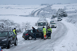 © Licensed to London News Pictures Ltd.. 01/02/2019. Bodmin Moor, UK. Rescue crews help stranded motorists on the A30 on Bodmin Moor, who were stranded last night by heavy snowfall. Most motorists were put the up on camp beds in the nearby Jamaica Inn. Photo credit: Mark Hemsworth/LNP