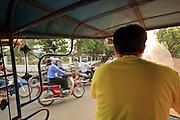 "Mar. 11, 2009 -- VIENTIANE, LAOS: Riding in a ""tuk-tuk"" or three wheeled taxi, in Vientiane, Laos. Tuk-tuks are popular in much of the developing world.  Photo by Jack Kurtz / ZUMA Press"
