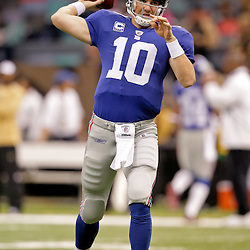 2009 October 18: New York Giants quarterback Eli Manning (10) throws during warm ups prior to kickoff of a 48-27 win by the New Orleans Saints over the New York Giants at the Louisiana Superdome in New Orleans, Louisiana.