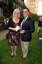 Actor ROBERT POWELL and his wife BABS at the Lady Taverners Westminster Abbey Garden Party, The College Garden, Westminster Abbey, London SW1 on 10th July 2007.<br /><br />NON EXCLUSIVE - WORLD RIGHTS