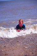 AJDMA4 Girl black wet suit body boarding breaking wave