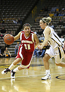 19 February 2009: Wisconsin guard Rae Lin D'Alie (11) tries to drive around Iowa guard Kristi Smith (11) during the second half of an NCAA women's college basketball game Thursday, February 19, 2009, at Carver-Hawkeye Arena in Iowa City, Iowa. Iowa defeated Wisconsin 72-65.