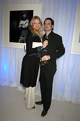Model JODIE KIDD and her husband AIDEN BUTLER attending the Tag Heuer party where an exhibition of photographs by Mary McCartney celebrating 15 exception women from 15 countries was unveiled at the Royal College of Arts, Kensington Gore, London on 8th February 2007.<br /><br />NON EXCLUSIVE - WORLD RIGHTS