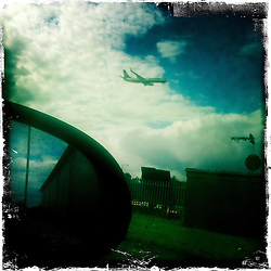 Jet landing at Edinburgh airport..Hipstamatic images taken on an Apple iPhone..©Michael Schofield.