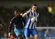 Brighton central defender, Lewis Dunk (5) beats Sheffield Wednesday striker Lucas Joao (18) to the ball during the Sky Bet Championship match between Brighton and Hove Albion and Sheffield Wednesday at the American Express Community Stadium, Brighton and Hove, England on 8 March 2016. Photo by Adam Rivers.