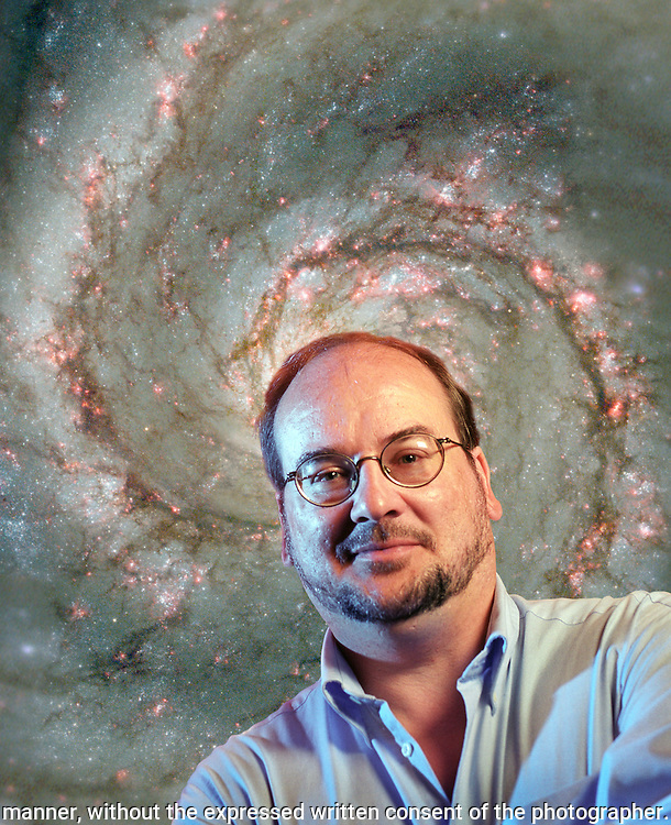 Astrophysicist Matthew Choptuik, a University of British Columbia professor in Vancouver BC. Shown at MacMillan Space Centre's planetarium. Behind him is the spiral galaxy Messier 51...©RICH FRISHMAN.ALL RIGHTS RESERVED..150 BRACKENWOOD AVE.LANGLEY WA 98260..360-221-1984 VOICE.360-221-4054 FAX