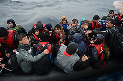 Refugees are seen on a boat after they rescued by Turkish coast guards while they were illegally trying to reach Greece's Lesbos island through the Aegean Sea, in Canakkale province of Turkey on October 27, 2015. Refugees who begin a journey with a hope to have high living standards away from conflicts, use Greece's Lesbos Island as a transit point on their way to Europe. Photo by Ali Atmaca/AA/ABACAPRESS.COM  | 521549_015 Canakkale Turquie Turkey