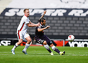 Derby County midfielder Bradley Johnson and Milton Keynes Dons defender Ben Reeves during the Sky Bet Championship match between Milton Keynes Dons and Derby County at stadium:mk, Milton Keynes, England on 26 September 2015. Photo by David Charbit.