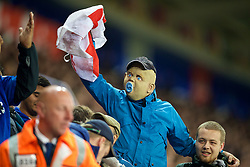 LEICESTER, ENGLAND - Tuesday, September 19, 2017: A Leicester City supporter, wearing a baby mask and holding a Cross of St. George flag, gestures to the away supporters during the Football League Cup 3rd Round match between Leicester City and Liverpool at the King Power Stadium. (Pic by David Rawcliffe/Propaganda)