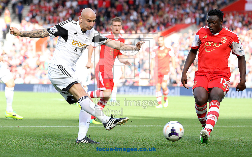 Picture by Paul Terry/Focus Images Ltd +44 7545 642257<br /> 06/10/2013<br /> Victor Wanyama of Southampton attempts to block a shot from Jonjo Shelvey of Swansea City during the Barclays Premier League match at the St Mary's Stadium, Southampton.