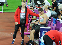Athletics - 2017 IAAF London World Athletics Championship - Day Thirteen, Evening Session<br /> <br /> Men's Javelin Final<br /> <br /> Johannes Vetter of Germany consoles team mate Andreas Hofmann after winning the gold medal at the London Stadium.<br /> <br /> COLORSPORT/ANDREW COWIE