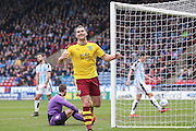 Burnley forward Sam Vokes (9) scores a goal and celebrates to make the score 0-2 during the Sky Bet Championship match between Huddersfield Town and Burnley at the John Smiths Stadium, Huddersfield, England on 12 March 2016. Photo by Simon Davies.