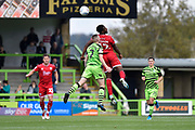 Nathan Ferguson (12) of Crawley Town heads the ball as he is challnged by Liam Shephard (2) of Forest Green Rovers during the EFL Sky Bet League 2 match between Forest Green Rovers and Crawley Town at the New Lawn, Forest Green, United Kingdom on 5 October 2019.
