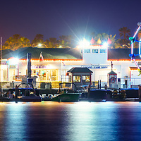 Newport Beach Balboa Fun Zone at night photo. The Balboa Fune Zone is a popular attraction in Orange County Southern California. Panoramic photo ratio is 1:3. Copyright ⓒ 2017 Paul Velgos with All Rights Reserved.