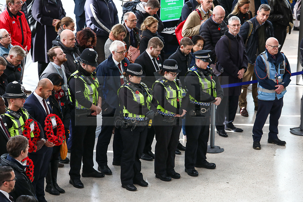 © Licensed to London News Pictures. 11/11/2019. London, UK. People gather for the two minute silence at Waterloo Station. Hundreds of people around the UK respect the two minute silence for Armistice Day today. Photo credit: Alex Lentati/LNP