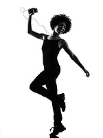 one mixed race african young teenager girl woman happy dancer dancing  listening music in studio shadow silhouette isolated on white background