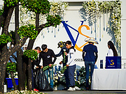 """04 NOVEMBER 2018 - BANGKOK, THAILAND: Workers put the decorations for the funeral of Vichai Srivaddhanaprabha at Wat Debsirin on the second day of funeral rites for Vichai. The VS are his initials. The """"Possible Man"""" reflects Vichai's legacy in Leicester because he was viewed as the man who made everything possible after Leicester won the 2015-16 Premier League Championship. Vichai was the owner of King Power, a Thai duty free conglomerate, and the Leicester City Club, a British Premier League football (soccer) team. He died in a helicopter crash at the King Power stadium in Leicester after a match on October 27. Vichai was Thailand's 5th richest man. The funeral is expected to last one week.  PHOTO BY JACK KURTZ"""