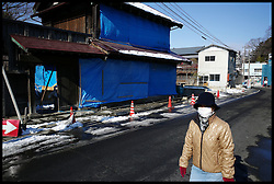 Construction workers carry out work on house's that were hit by the Tsunami in the city of Shiogama, Miyagi. The Town was hit by the Tsunami, Saturday February 4, 2012. Photo By Andrew Parsons/i-Images