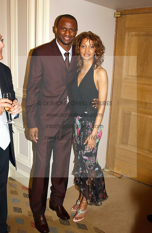 Footballer PATRICK VIEIRA and his wife SHELLEY at a dinner hosted by footballer Patrick Vieira and the Diambars UK Charital Trust at The Landmark Hotel, 222 Marylebone Road, London NW1 on 3rd February 2005.<br /><br />NON EXCLUSIVE - WORLD RIGHTS