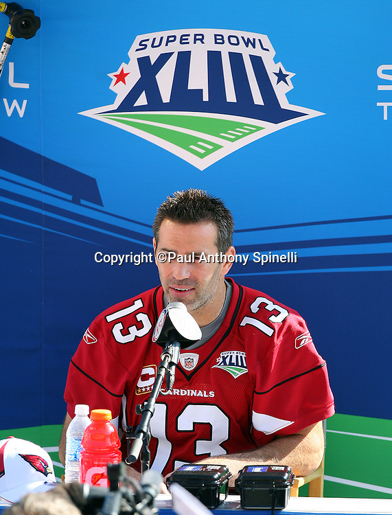TAMPA, FL - JANUARY 27: Quarterback Kurt Warner #13 of the NFC Arizona Cardinals speaks to the media during Super Bowl XLIII Media Day at Raymond James Stadium on January 27, 2009 in Tampa, Florida. ©Paul Anthony Spinelli *** Local Caption *** Kurt Warner