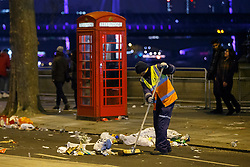© Licensed to London News Pictures. 01/01/2017. London, UK. Cleaning takes place as revellers celebrating the New Year in central London leave many litter behind during the first hours of 2017 on January 1. Photo credit: Tolga Akmen/LNP
