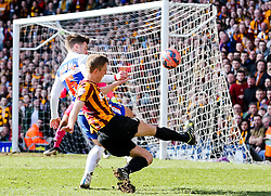 Bradford City Captain Stephen Darby crosses the ball  - Photo mandatory by-line: Matt McNulty/JMP - Mobile: 07966 386802 - 07/03/2015 - SPORT - Football - Bradford - Valley Parade - Bradford City vReading - FA Cup - Quarter Final